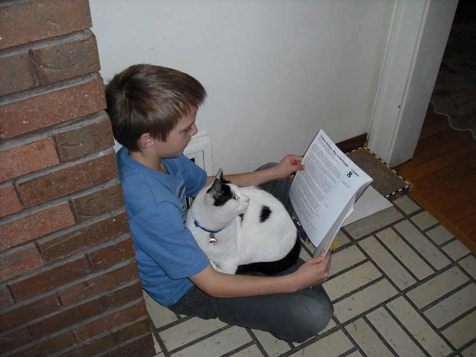 Reading with the cat.